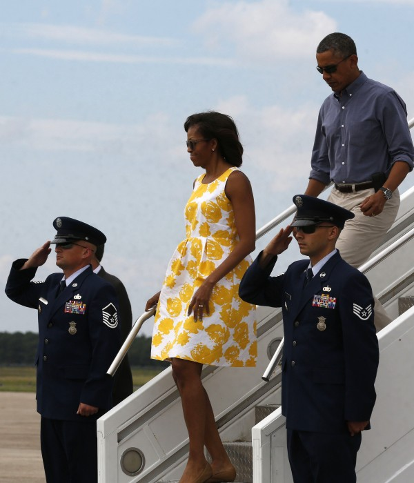 President Barack Obama and first lady Michelle Obama arrive at the Cape Cod Coast Guard Air Station in Massachusetts to start their Martha's Vineyard vacation on Saturday.