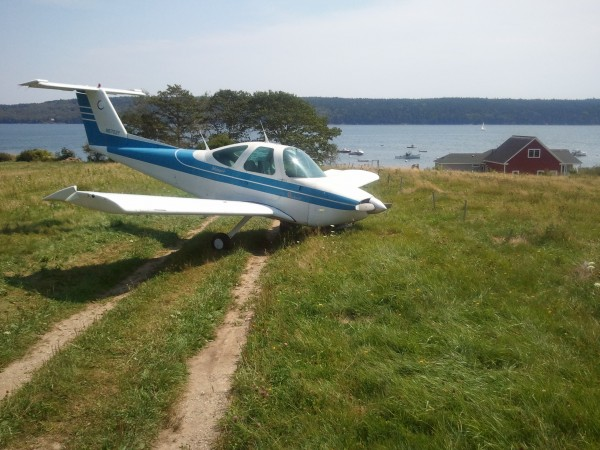A plane that made an emergency landing in a Blue Hill field remained there Monday morning.