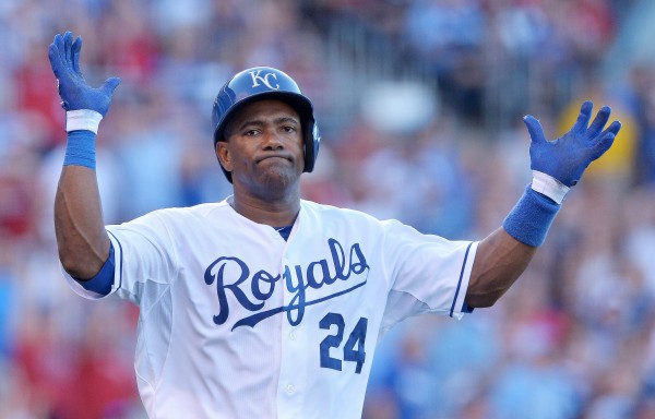 The Kansas City Royals' Miguel Tejada throws up his hands after flying out to end the first inning against the Boston Red Sox on Aug. 10, at Kauffman Stadium in Kansas City, Mo.