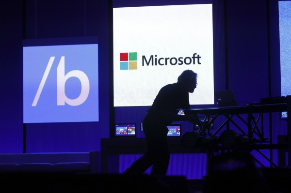 A technician moves equipment prior to Microsoft CEO Steve Ballmer's keynote address at the Microsoft &quotBuild&quot conference in San Francisco, California, in this June 26, 2013 file picture.