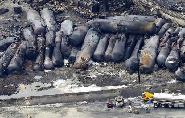 A firefighter stands close to the remains of a train wreckage in Lac Megantic in this file photo taken July 8, 2013.