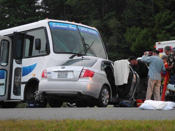 Witnesses said the driver of a Subaru appeared to turn left into the path of the oncoming charter bus at the intersection of U.S. Route 1 and Northport Avenue in Belfast on Saturday evening, according to police.