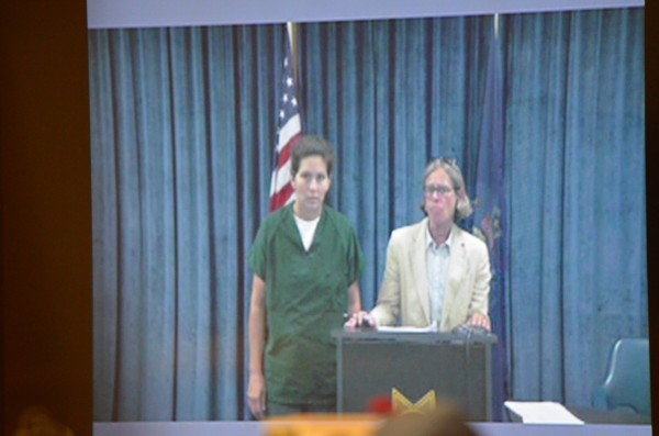 BethMarie Retamozzo (left) appears on a television screen in Waterville District Court on Wednesday.