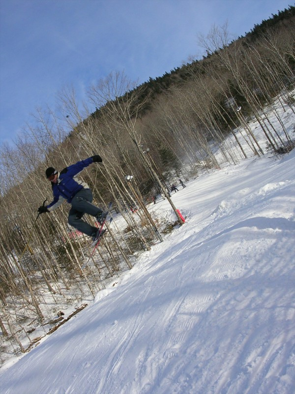 A skier gets some air after clearing a jump at the freestyle terrain park at Big Rock Ski Area in Mars Hill in 2005.
