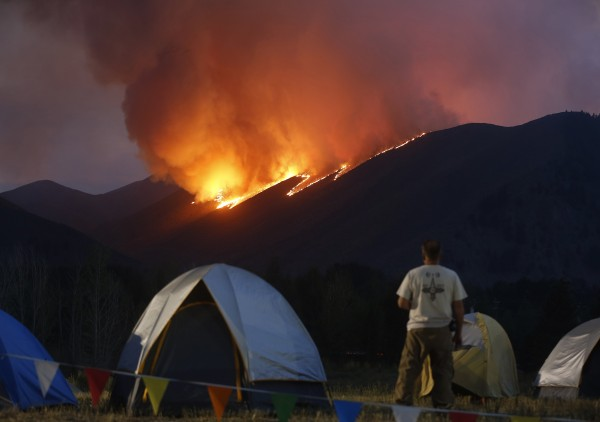 Flames blaze down a ridge as the Beaver Creek wildfire rages Friday outside Hailey, Idaho. Officials ordered more evacuations on Saturday.