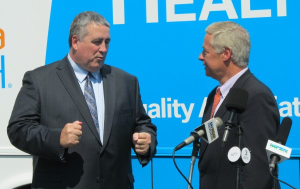 Democrat Steve Woods, left, talks with U.S. Rep. Mike Michaud, D-Maine, Wednesday morning at the Falmouth headquarters of Woods' TideSmart Global facility. Woods announced Wednesday that he would be dropping out of the 2014 Maine gubernatorial race and endorsing Michaud.