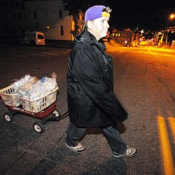 Tanya Caron of Lewiston walks along one of her five New Auburn newspaper routes during the early morning hours recently. Caron was unemployed and homeless five months ago, spending her nights at Hope Haven Gospel Mission. Today, she has an apartment and works seven mornings a week delivering the Sun Journal.