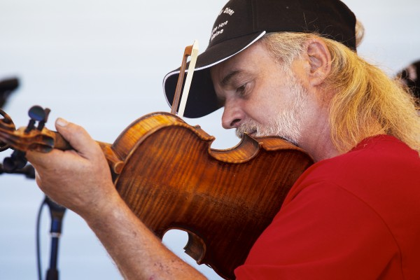 Martin &quotMark&quot Morris of St. Francis plays the fiddle Saturday at the American Folk Festival on the Maine Folklife Center stage. Morris learned to play the fiddle by ear from old-time fiddlers in the St. John Valley including Simon St. Pierre.