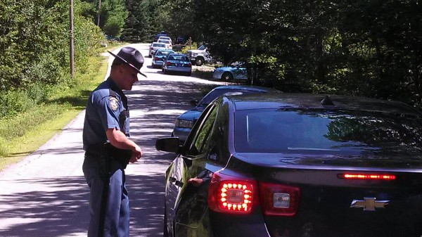 Police redirect cars on Peakes Hill Road Thursday afternoon in Dedham.
