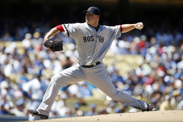 Boston Red Sox starting pitcher Jon Lester delivers against the Los Angeles Dodgers on Saturday during the second inning of an MLB Interleague baseball game in Los Angeles. Boston won 4-2.