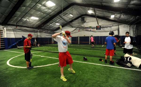 The Maine District 3 baseball team practices inside at Fields4Kids on Thursday due to rainy weather. The local team will play their first game of the Senior Little League World Series against Canada on Sunday at Mansfield Stadium.