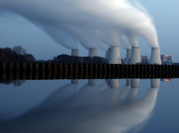 File photo of steam billowing from the cooling towers of Vattenfall's Jaenschwalde brown coal power station reflected in the water of a lake near Cottbus, eastern Germany December 2, 2009.