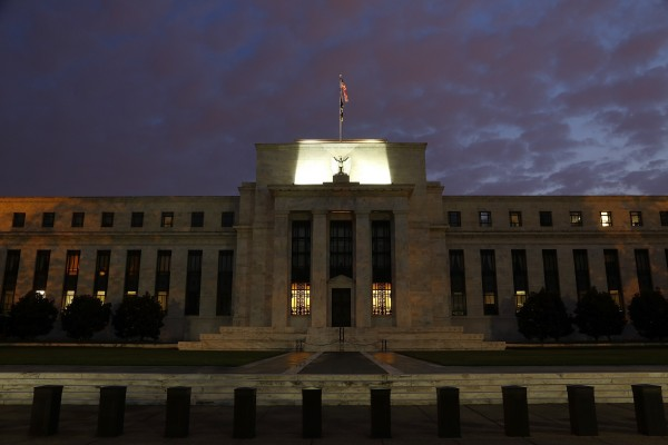 A general view of the U.S. Federal Reserve building as the morning sky breaks over Washington, July 31, 2013.