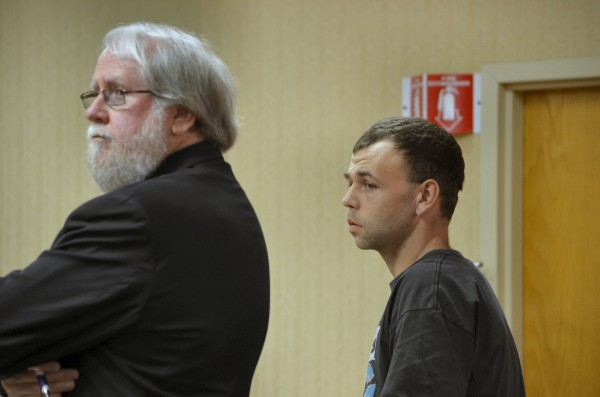 Jason Thompkins of Bangor, right, listens to Judge Evert Fowle in Newport District Court on Friday. His attorney, Richard Hall of Bangor, stands alongside.