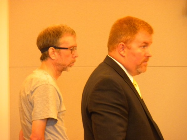 John A. Weckerly, left, stands on July 25, 2013, at the Penobscot County Judicial Center with his attorney Kirk Bloomer on the first day of his trial.