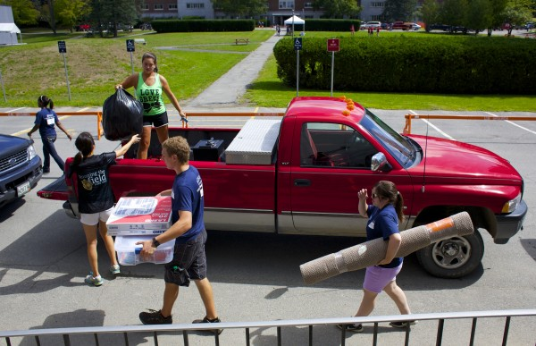 Members of Maine Hello help new students move into University of Maine in Orono Friday morning at the start of Welcome Weekend.
