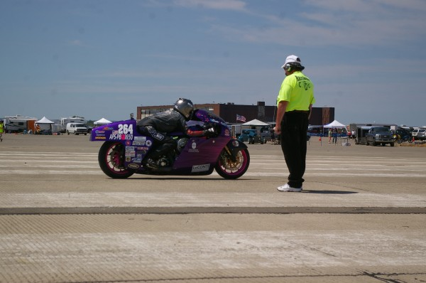 "Jody Perewitz of Bridgewater, Mass., will be racing the Perewitz Cycle Fabrication motorcycle as she attempts to improve her record speed of 208 mph set at the Bonneville Salt Flats in Utah this week. She has the title of ""Fastest Woman on an American V-Twin""."