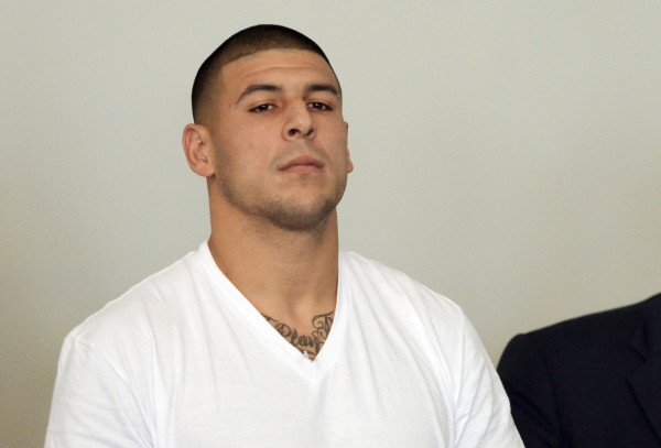 New England Patriots tight end Aaron Hernandez is arraigned on charges of murder and weapons violations after being arrested, June 26, 2013. He was formally indicted on August 22, 2013.