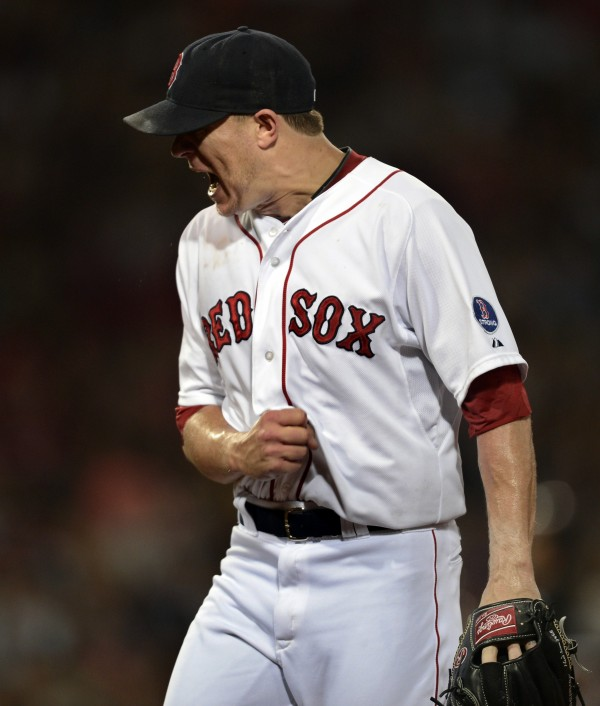 Boston Red Sox starting pitcher Jake Peavy reacts after the third inning against the Chicago White Sox in their American League game at Fenway Park in Boston Saturday night.