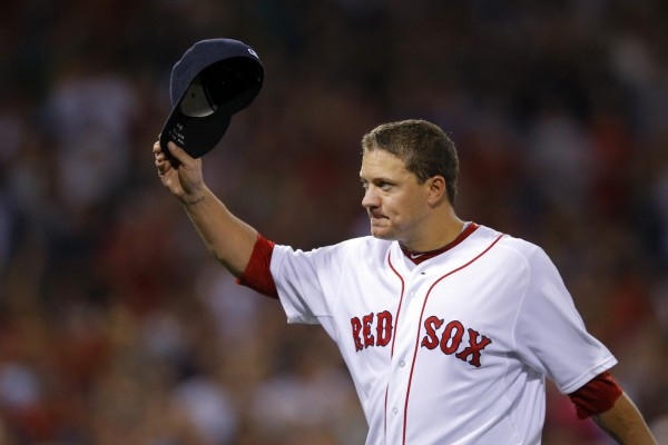 Boston Red Sox pitcher Jake Peavy acknowledges cheers from the crowd as he leaves in the eighth inning against the Arizona Diamondbacks at Fenway Park in Boston Saturday night. It was Peavy's first start for the Red Sox since being traded to the team, which won 5-2.