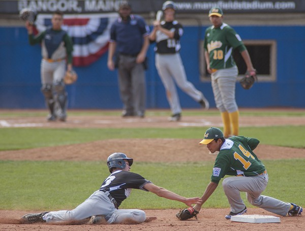 Team Latin America second baseman Francisco Perez (14) tags out runner Drew Jarmuz (13) of Team U.S. East's Kennett Square, Pa., on a steal attempt in the fourth inning of their Senior League World Series championship at Mansfield Stadium in Bangor, Maine, Saturday August 17, 2013.