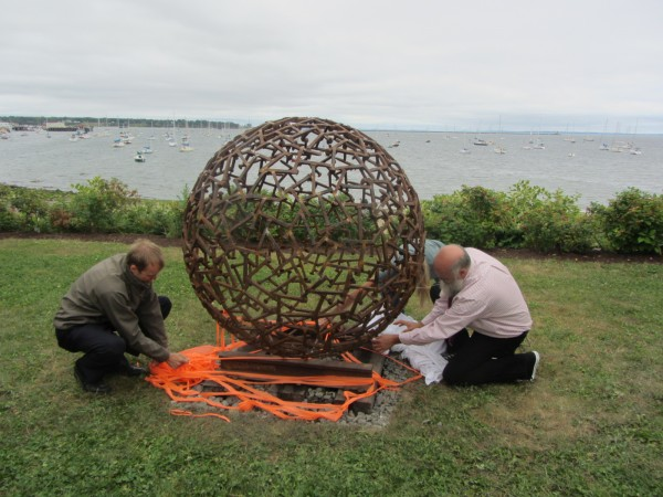 Artist Jay Sawyer (right) and Mayor Will Clayton (left) help unveil Sawyer's sculpture &quotRidin' the Rails to Rockland&quot at a ceremony noon Thursday at Sandy Beach Park in Rockland.
