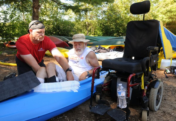 Mike Henry of Maine Adaptive Sports and Recreation works with George St. Hilaire of Sanford as he builds a custom seat to improve the balance and comfort of St. Hilaire's kayak. St. Hilaire, a disabled veteran, was at Camp Wavus in Jefferson on Saturday for a veterans retreat offered by Veterans No Boundaries.