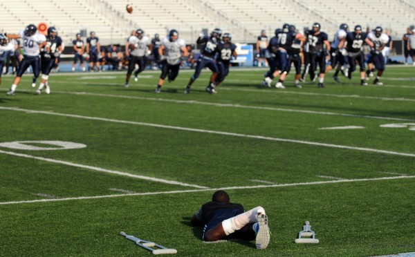 UMaine's No. 20, Tayvon Hall, watches from the sidelines as the UMaine football team plays in the Blue-White scrimmage on Tuesday at Morse Field on the UMaine campus in Orono.