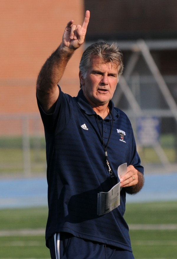 UMaine head football coach Jack Cosgrove calls out instructions during the Blue-White scrimmage on Tuesday at Morse Field on the UMaine campus in Orono.