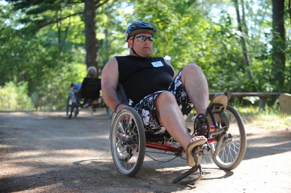 D.J. Martin of Lagrange bikes during a veterans summer sports retreat offered by Veterans No Boundries at Camp Wavus in Jefferson on Saturday.