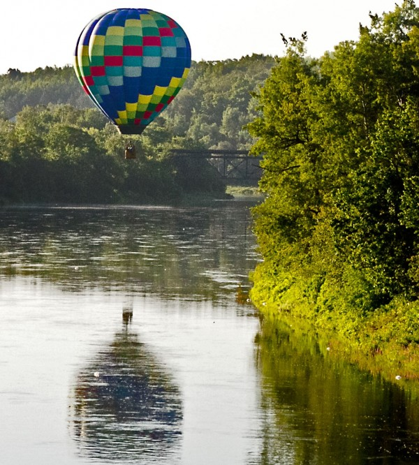 The balloon Tracer, piloted by Wendell Purvis of Tallahassee, Fla., flies over the Aroostook River one recent day. The balloon arrived early for the 10th Annual Crown of Maine Balloon Fest, which will be held Thursday, Aug. 22, through Sunday, Aug. 25, at the Northern Maine Fairgrounds in Presque Isle. Hosted by the Central Aroostook Chamber of Commerce and the Mapleton Lions Club, the festival will feature six scheduled launches, tethered rides, music, artisans, food, races, a street fair, children's activities and more.