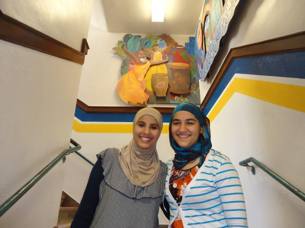 From left, Zahra Rikan, a former Portland High School student and Maryam Abdullah, currently at the school, helped work on the mural &quotWith Eyes in our Hearts&quot unveiled at Portland High School Tuesday. Both students are from Iraq.