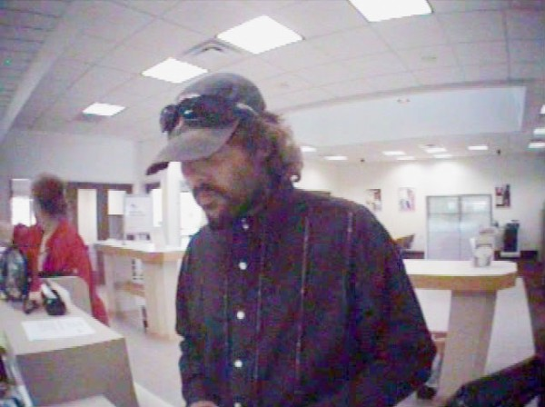 Surveillance photos of a man Newport police say robbed a Key Bank in Newport recently. Police are searching for the suspect.