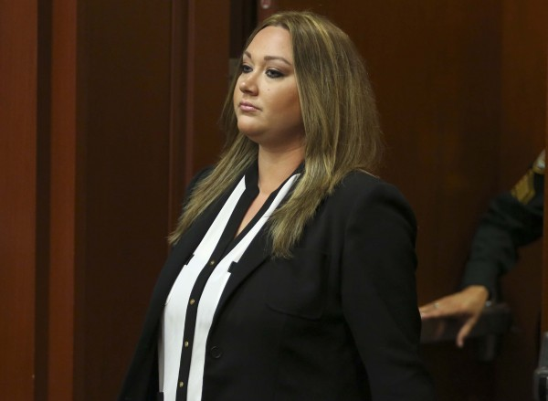 Shellie Zimmerman, wife of George Zimmerman, pleaded guilty to a lesser form of perjury at the Seminole County Courthouse in Sanford, Florida, Wednesday, August 28, 2013.
