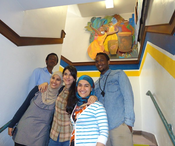 Mural &quotWith Eyes in our Hearts&quot unveiled at Portland High School Tuesday. Front row from left, students Zahra Rikan of Iraq, Nilab Nasrat of Afghanistan and Maryam Abdullah of Iraq. Back row Ulrich Kavuyimbo and Quentin Ndayishimiye of Africa.