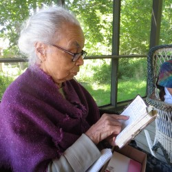 Angela Taylor, 98, reads from a journal in which she has recorded summer visits to Islesford, Maine since 1957.