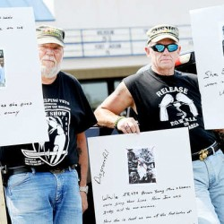 "Vietnam veterans Steve Spooner, left, of Auburn and Dane Tripp of Poland protest Jane Fonda's role in the movie ""The Butler"" at Flagship Cinemas in Lewiston on Monday."
