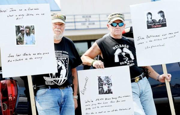 Vietnam veterans Steve Spooner, left, of Auburn and Dane Tripp of Poland protest Jane Fonda's role in the movie &quotThe Butler&quot at Flagship Cinemas in Lewiston on Monday.