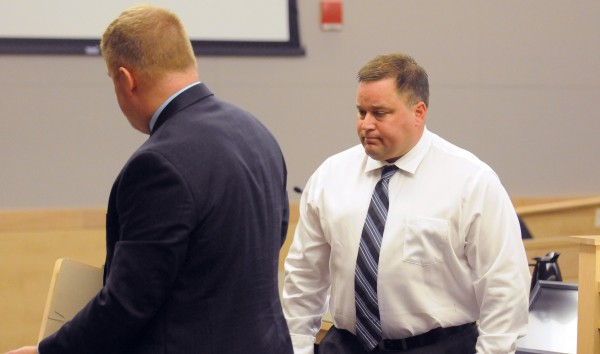 Brewer Police captain Christopher Martin (right) and his attorney Kirk Bloomer leave the court room at the Penobscot Judicial Center Wednesday. Martin pleaded guilty to the drunken driving charge and will participate in an alternative sentencing program.