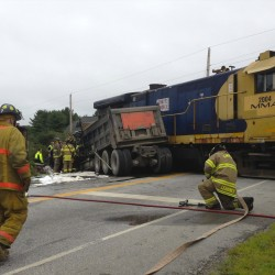 Police say brake failure on dump truck may have led to collision with train in Hampden