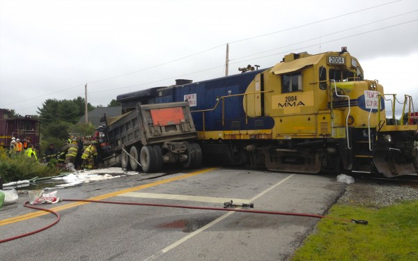 A dump truck collided with a Montreal, Maine and Atlantic Railway train Thursday morning on Western Avenue in Hampden.