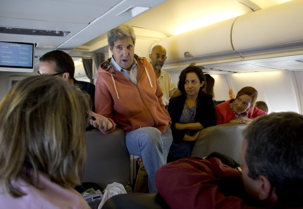 U.S. Secretary of State John Kerry speaks with the press aboard his plane after departing Islamabad, en route to London, August 2, 2013.