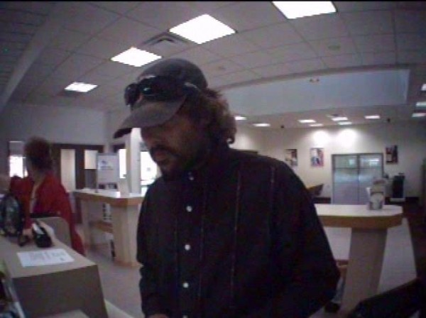 Surveillance photos of a man Newport police say robbed a Key Bank in Newport on Thursday afternoon. Police are searching for the suspect.