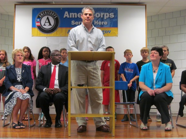 LearningWorks Executive Director Ethan Strimling is flanked by Riverton Elementary School Principal Jeanne Malia, Portland Public Schools Superintendent Emmanuel Caulk, Maine Commission for Community Service Executive Director Maryalice Crofton and a row of Portland school children Thursday morning for a news conference at the Riverton school.