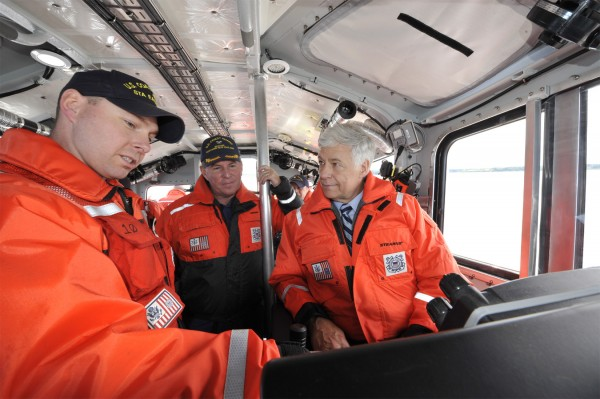 U.S. Coast Guard Chief Petty Officer Austin Olmstead (left), officer in charge of Coast Guard Station Eastport, shows Rep. Mike Michaud the capabilities of the station's new response boat-medium (RB-M) as Captain Jim McPherson (center) looks on in 2011 off the coast of Eastport.