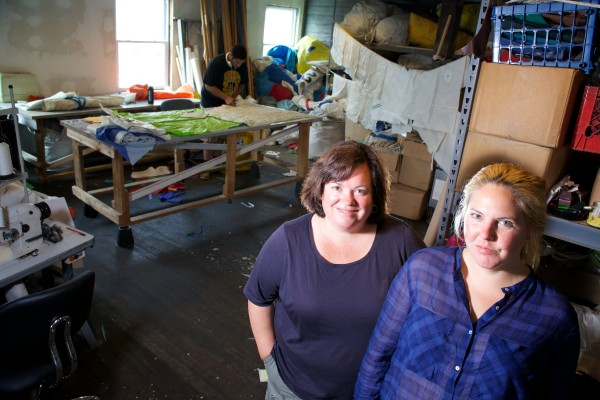 Beth Shissler (left) and Hannah Kibiak run Sea Bags on Customs House Wharf in Portland. The company, which makes products from recycled sails, is expanding from 1,500 square feet to 4,500 square feet on the wharf.