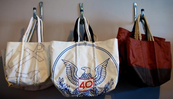 Stitched and printed designs grace Sea Bags products on Customs House Wharf in Portland Wednesday. The company, which makes products from recycled sails, is expanding from 1,500 square feet to 4,500 square feet on the wharf.