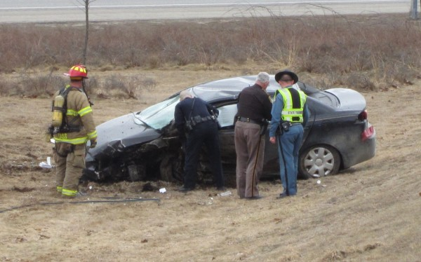 In this March 2013 file photo, police examine a black Mitsubishi that crashed after a high-speed chase on Interstate 295. The driver, Dylan Libby, was sentenced to seven years in jail on August 29, 2013, for robbing a Rite Aid and leading police on the chase in March.