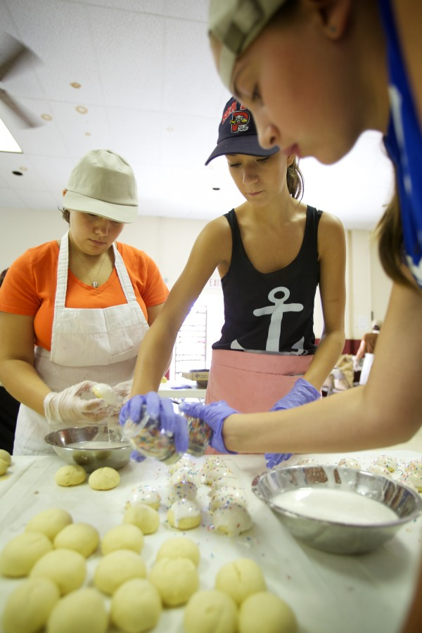 Volunteers Cat Bernier, 12, (left) Nicola Libby, 16, (center) and Maria Buck help make traditional anise cookies Wednesday at St. Peter's Church in Portland in preparation for this weekend's 88th annual Italian Bazaar.
