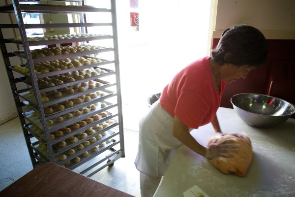 Eleanor Zappia, 89, kneads dough for anise loaf Wednesday at St. Peter's Church in Portland in preparation for this weekend's 88th annual Italian Bazaar.